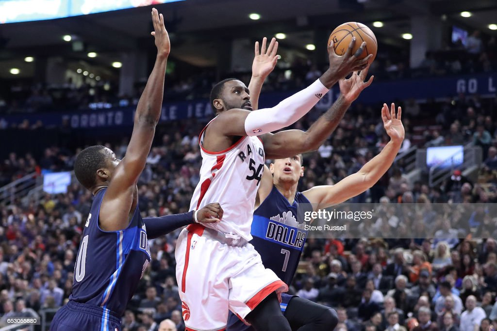 TORONTO, ON- MARCH 13 - Toronto Raptors forward Patrick Patterson (54) goes in for a lay up as the Toronto Raptors beat the Dallas Mavericks 100-78 at the Air Canada Centre in Toronto. March 13, 2017.