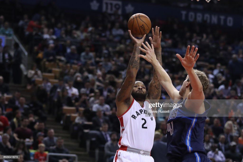 TORONTO, ON- MARCH 13 - Toronto Raptors forward P.J. Tucker (2) puts up a shot over Dallas Mavericks forward Dirk Nowitzki (41) as the Toronto Raptors play the Dallas Mavericks at the Air Canada Centre in Toronto. March 13, 2017.