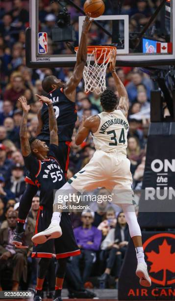 Toronto Raptors forward Serge Ibaka deniest Milwaukee Bucks forward Giannis Antetokounmpo at the rim as Toronto Raptors guard Delon Wright looks up...