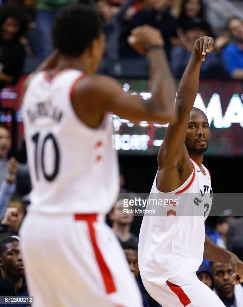 Toronto Raptors forward Serge Ibaka looks back to Toronto Raptors guard DeMar DeRozan after hitting a three ball Toronto Raptors vs New Orleans...