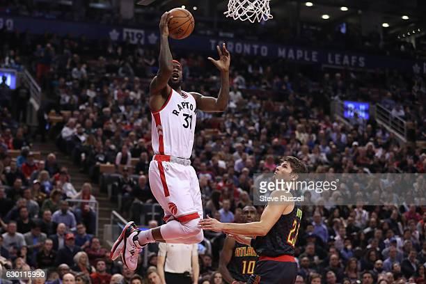 TORONTO ON DECEMBER 16 Toronto Raptors forward Terrence Ross lays the ball in in front of Atlanta Hawks guard Kyle Korver as the Toronto Raptors lose...