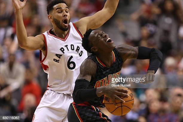 TORONTO ON DECEMBER 16 Toronto Raptors guard Cory Joseph fouls Atlanta Hawks guard Dennis Schroder in the closing seconds of the game as the Toronto...
