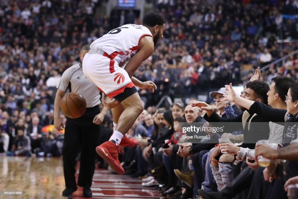TORONTO, ON- MARCH 13 - Toronto Raptors guard Cory Joseph (6) saves a ball going out of bounds as the Toronto Raptors play the Dallas Mavericks at the Air Canada Centre in Toronto. March 13, 2017.
