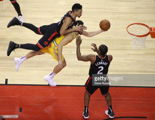 TORONTO ON NOVEMBER 29 Toronto Raptors guard Danny Green fouls Golden State Warriors guard Klay Thompson in front of Toronto Raptors forward Kawhi...