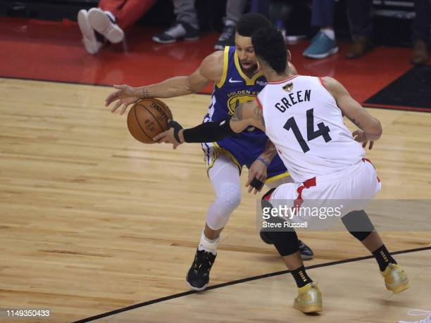 TORONTO ON JUNE 10 Toronto Raptors guard Danny Green knocks the ball away from Golden State Warriors guard Stephen Curry as the Toronto Raptors lose...