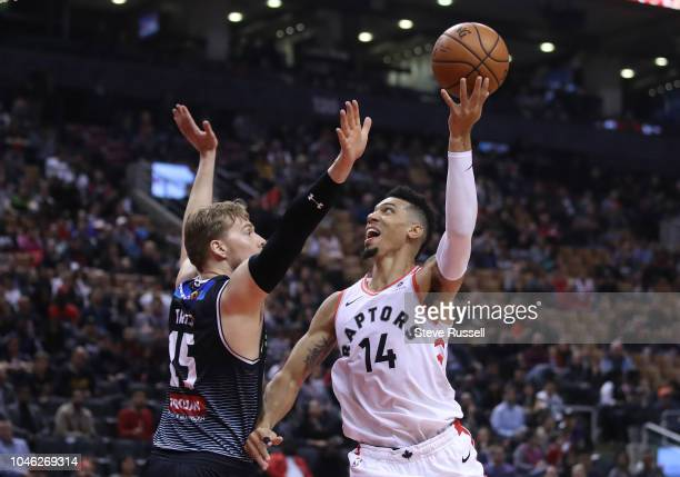 TORONTO ON OCTOBER 5 Toronto Raptors guard Danny Green puts up a shot over Melbourne United forward Daniel Trist as the Toronto Raptors play...