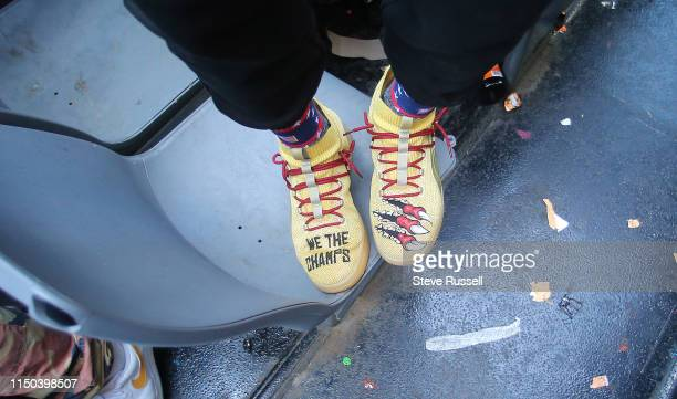TORONTO ON JUNE 17 Toronto Raptors guard Danny Green sports We The Champs shoes as the Toronto Raptors hold their victory parade after beating the...