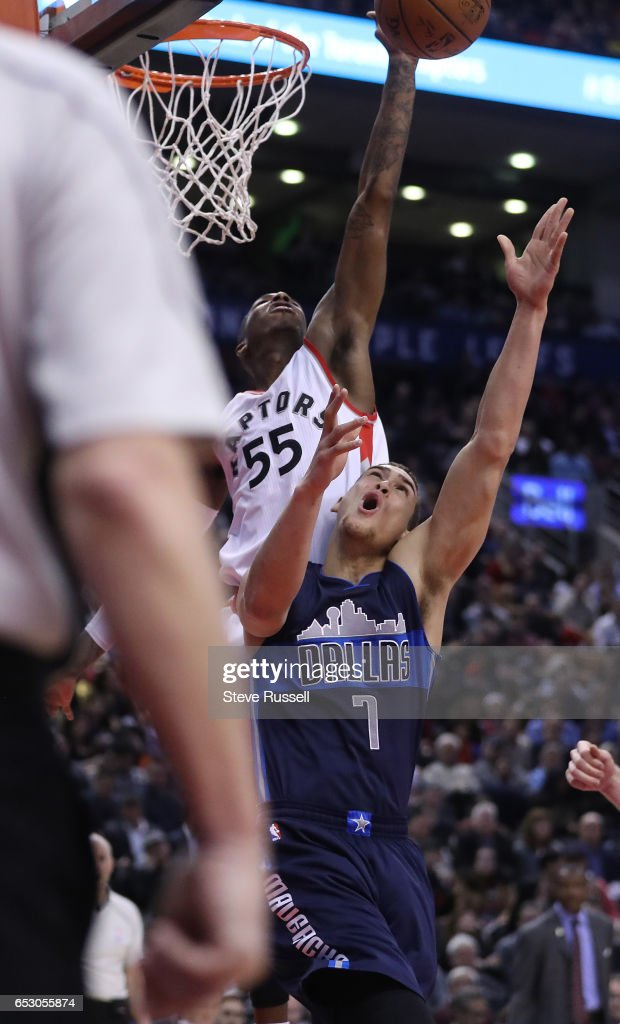 TORONTO, ON- MARCH 13 - Toronto Raptors guard Delon Wright (55) blocks a shot by Dallas Mavericks forward Dwight Powell (7) as the Toronto Raptors beat the Dallas Mavericks 100-78 at the Air Canada Centre in Toronto. March 13, 2017.