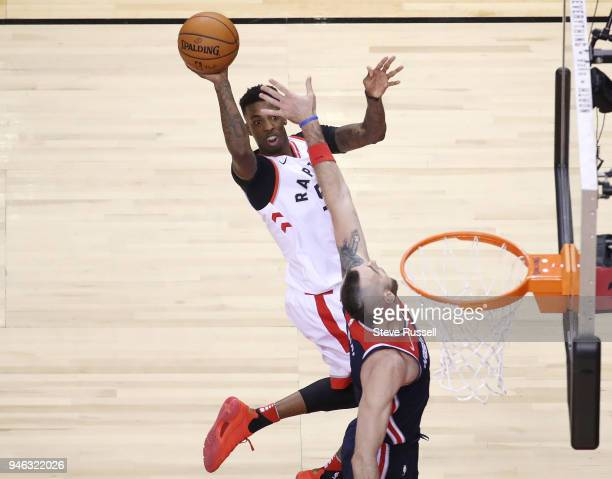 Toronto Raptors guard Delon Wright gets a shot up over Washington Wizards center Marcin Gortat as the Toronto Raptors open the first round of the NBA...