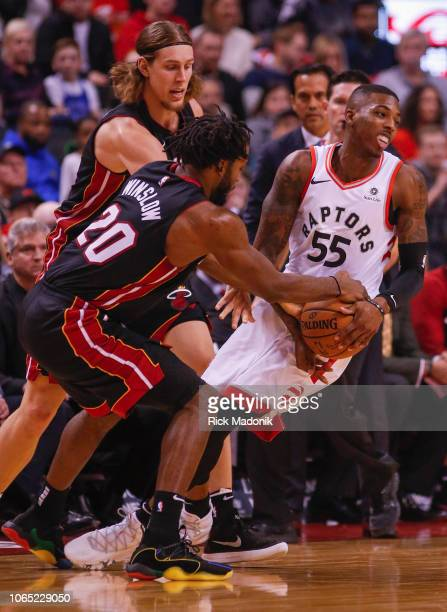 Toronto Raptors guard Delon Wright gets double teamed by Miami Heat forward Justise Winslow and Miami Heat forward Kelly Olynyk and coughs up the...