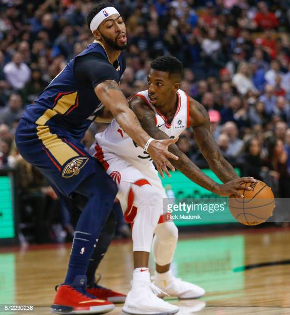 Toronto Raptors guard Delon Wright looks to pass as New Orleans Pelicans forward Anthony Davis keeps close tabs Toronto Raptors vs New Orleans...