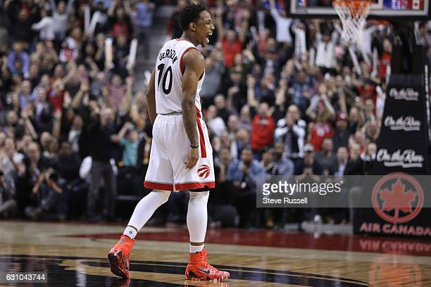 TORONTO ON JANUARY 5 Toronto Raptors guard DeMar DeRozan celebrates a clutch basket by Kyle Lowry as the Toronto Raptors beat the Utah Jazz 10193 at...