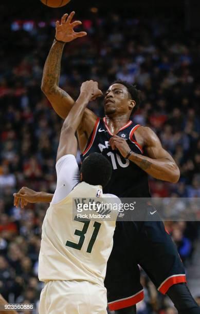 Toronto Raptors guard DeMar DeRozan deflects the pass of Milwaukee Bucks forward John Henson after DeRozan lost the ball. Toronto Raptors vs...