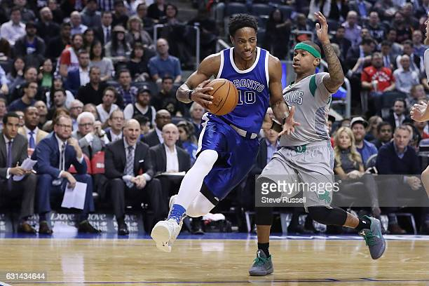 TORONTO ON JANUARY 10 Toronto Raptors guard DeMar DeRozan drives against Boston Celtics guard Isaiah Thomas as the Toronto Raptors wearing their...