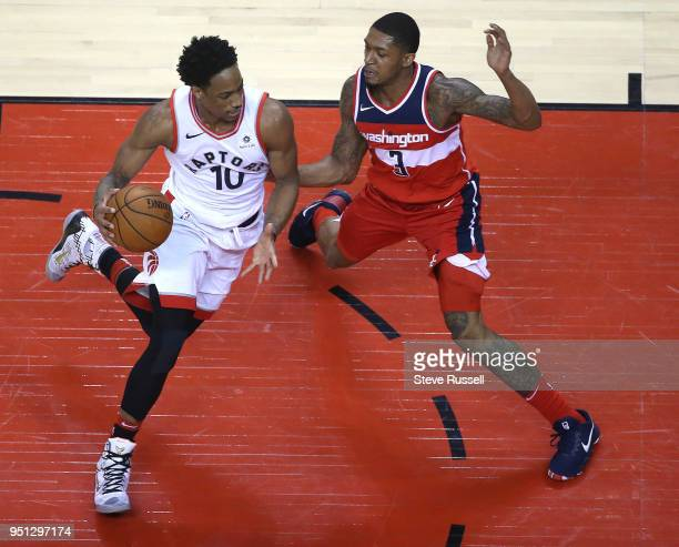 TORONTO ON APRIL 25 Toronto Raptors guard DeMar DeRozan drives against Washington Wizards guard Bradley Beal as the Toronto Raptors win game five of...