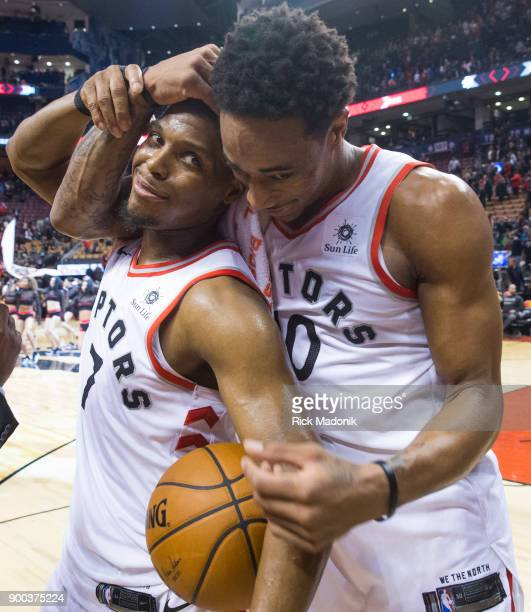 Toronto Raptors guard DeMar DeRozan gives Toronto Raptors guard Kyle Lowry a hug from behind as he ends a TV interview post game Toronto Raptors vs...