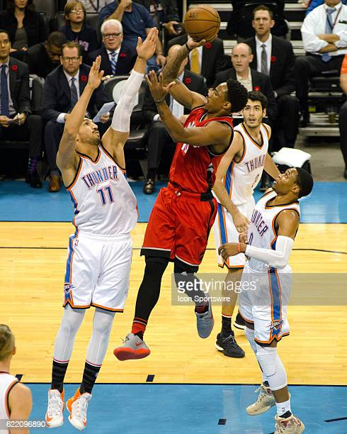 Toronto Raptors Guard DeMar DeRozan goes for the jump shot while Oklahoma City Thunder Center Enes Kanter tries for the block on November 9 at the...