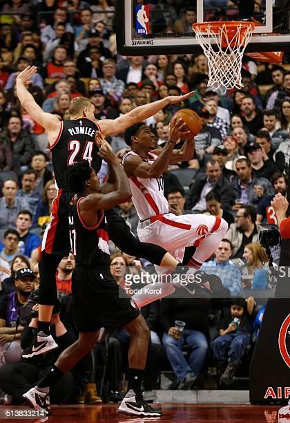 Toronto Raptors guard DeMar DeRozan goes to the basket against Portland Trail Blazers centre Mason Plumlee and Portland Trail Blazers centre Ed Davis...
