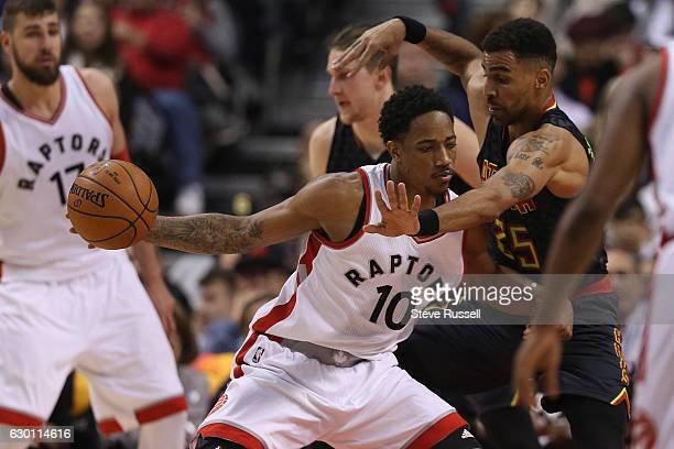 TORONTO ON DECEMBER 16 Toronto Raptors guard DeMar DeRozan is defended by Atlanta Hawks forward Thabo Sefolosha as the Toronto Raptors play the...