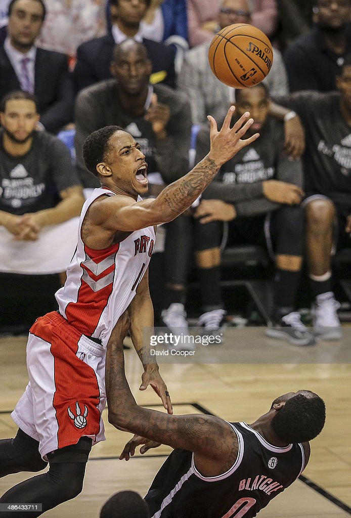 Toronto Raptors guard DeMar DeRozan (10) picks up an offensive foul (his 5th) on Brooklyn Nets centre Andray Blatche (0) : News Photo