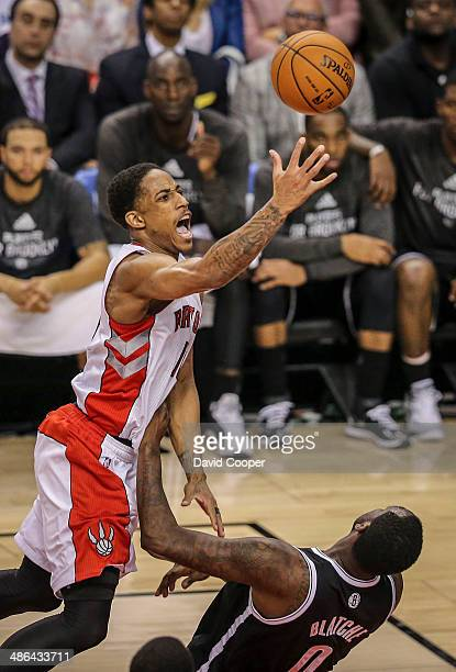 TORONTO ON APRIL 22 Toronto Raptors guard DeMar DeRozan picks up an offensive foul on Brooklyn Nets centre Andray Blatche during game two between the...