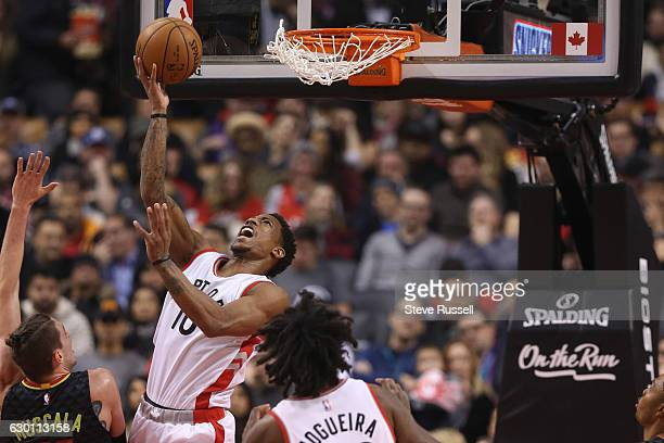 TORONTO ON DECEMBER 16 Toronto Raptors guard DeMar DeRozan soars under the basket and scores as the Toronto Raptors play the Atlanta Hawks at the Air...