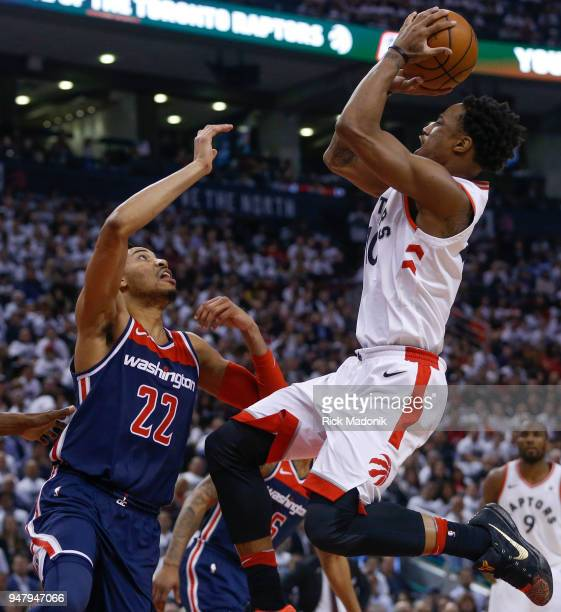 Toronto Raptors guard DeMar DeRozan throws up a two pointer as Washington Wizards forward Otto Porter Jr watches from the ground Toronto Raptors vs...