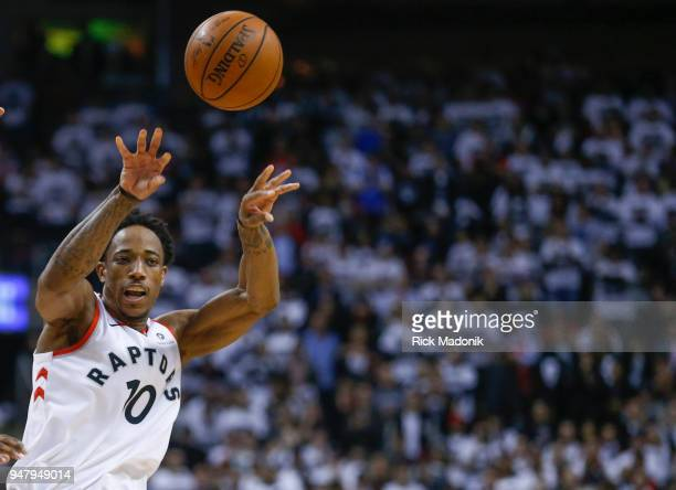 Toronto Raptors guard DeMar DeRozan tosses a pass Toronto Raptors vs Washington Wizzards in 1st half action of Game 2 of NBA Eastern Conference first...