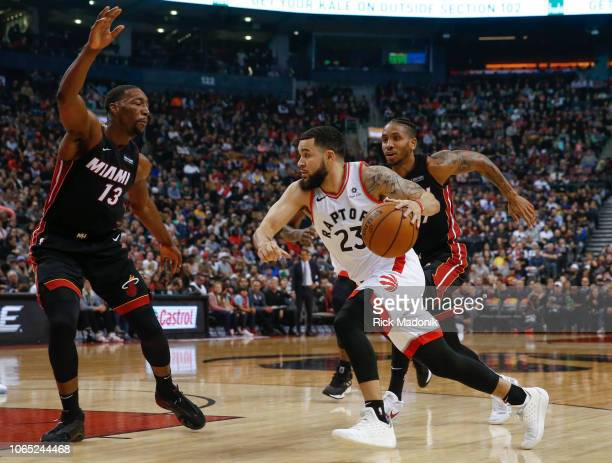 Toronto Raptors guard Fred VanVleet drives and finds Miami Heat center Bam Adebayo about to impede his progress Toronto Raptors vs New Orleans...