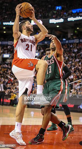 TORONTO ON APRIL 14 Toronto Raptors guard Greivis Vasquez shooting to make it 101 for the Raptors late in the gameguarded by Milwaukee Bucks guard...