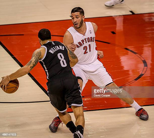 TORONTO ON APRIL 22 Toronto Raptors guard Greivis Vasquez tries to guard Brooklyn Nets guard Deron Williams in the Toronto end during game two...