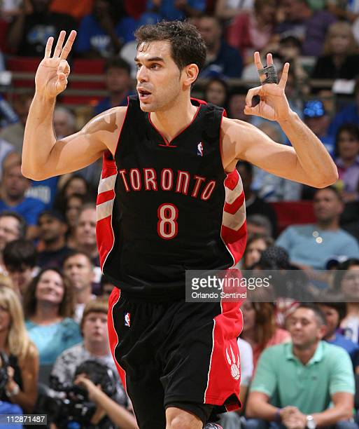 Toronto Raptors guard Jose Calderon holds up three fingers after dropping in a threepoint basket late in game against the Orlando Magic The Raptors...