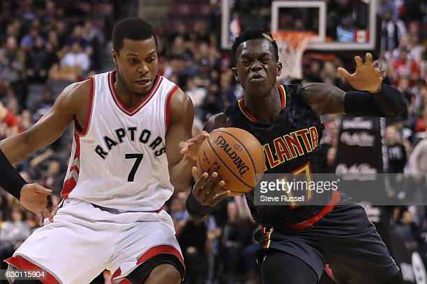 TORONTO ON DECEMBER 16 Toronto Raptors guard Kyle Lowry and Atlanta Hawks guard Dennis Schroder collide as the Toronto Raptors lose to the Atlanta...