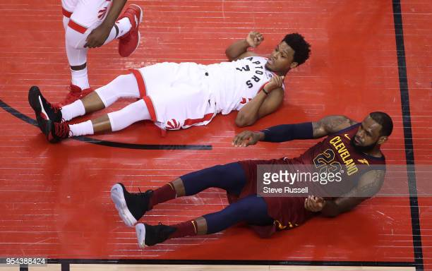 TORONTO ON MAY 3 Toronto Raptors guard Kyle Lowry and Cleveland Cavaliers forward LeBron James look to see who will be called for the foul it was...