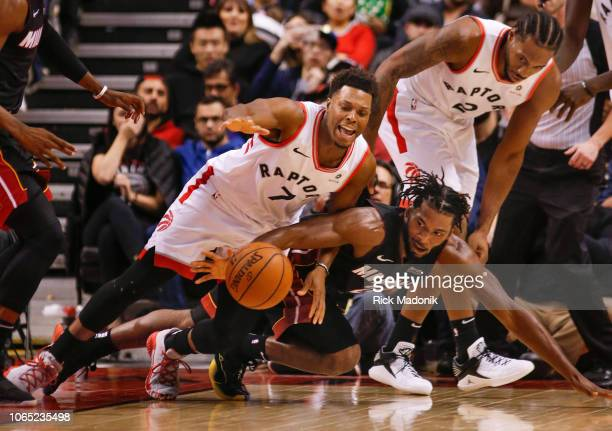 Toronto Raptors guard Kyle Lowry and Miami Heat forward Justise Winslow scramble after the loose ball Toronto Raptors vs New Orleans Pelicans in 2nd...