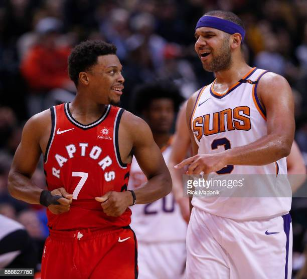Toronto Raptors guard Kyle Lowry and Phoenix Suns forward Jared Dudley have a friendly word as they come out for the 4th quarter Toronto Raptors vs...
