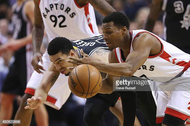 TORONTO ON JANUARY 24 Toronto Raptors guard Kyle Lowry and San Antonio Spurs guard Danny Green chase a loose ball as the Toronto Raptors play the San...