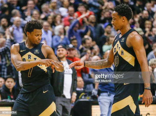Toronto Raptors guard Kyle Lowry and Toronto Raptors guard DeMar DeRozan near the end of the game with seconds left and a lead Toronto Raptors vs...