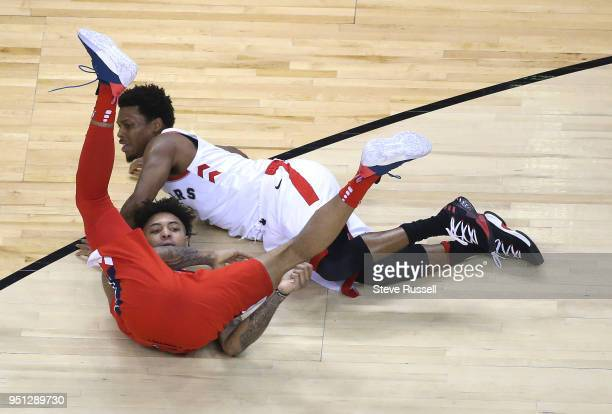 TORONTO ON APRIL 25 Toronto Raptors guard Kyle Lowry and Washington Wizards forward Kelly Oubre Jr get tangled up as the Toronto Raptors play game...