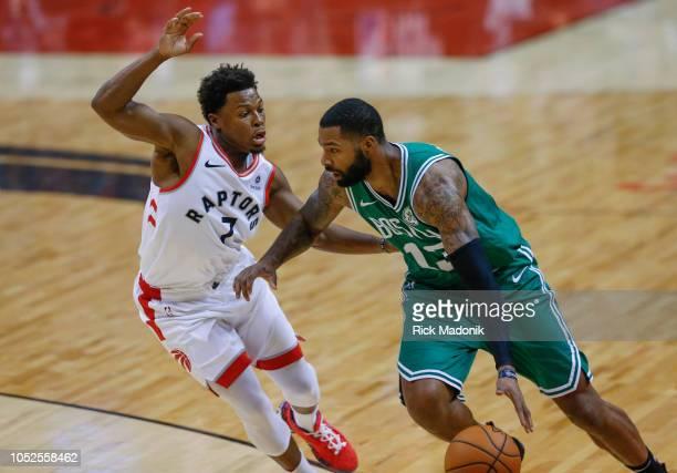 Toronto Raptors guard Kyle Lowry defends against Boston Celtics forward Marcus Morris Toronto Raptors vs Boston Celtics in 1st half action of NBA...
