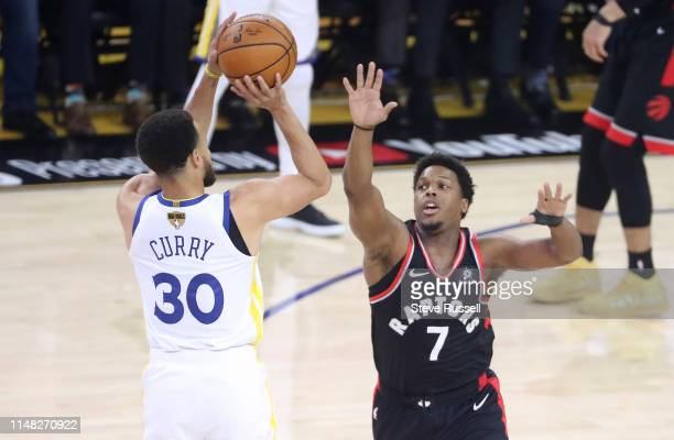Toronto Raptors guard Kyle Lowry defends against Golden State Warriors guard Stephen Curry as the Toronto Raptors play the Golden State Warriors in...