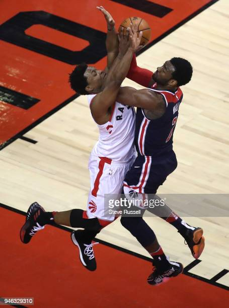 TORONTO ON APRIL 14 Toronto Raptors guard Kyle Lowry defends against Washington Wizards guard John Wall as the Toronto Raptors open the first round...