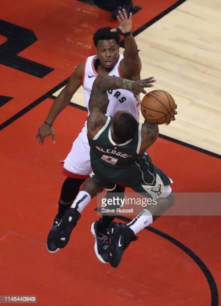 Toronto Raptors guard Kyle Lowry defends Milwaukee Bucks guard Eric Bledsoe as the Toronto Raptors beat the Milwaukee Bucks in game four 120-102 to...