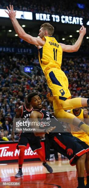 Toronto Raptors guard Kyle Lowry draws a charge from Indiana Pacers center Domantas Sabonis Toronto Raptors vs Indiana Pacers in 1st half action of...