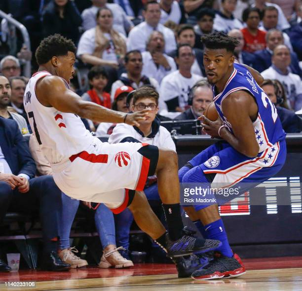 Toronto Raptors guard Kyle Lowry draws a charging foul against Philadelphia 76ers guard Jimmy Butler . Toronto Raptors vs Philadelphia 76ers in 1st...
