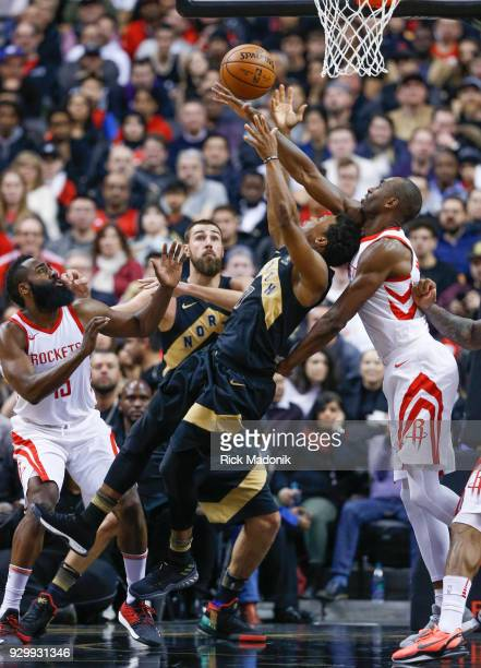 Toronto Raptors guard Kyle Lowry draws a foul from Houston Rockets forward Luc Mbah a Moute as Toronto Raptors center Jonas Valanciunas and Houston...