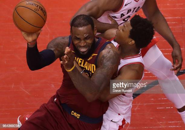 Toronto Raptors guard Kyle Lowry fouls Cleveland Cavaliers forward LeBron James as the Toronto Raptors play the Cleveland Cavaliers in the second...