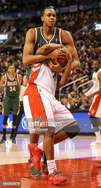 Toronto Raptors guard Kyle Lowry gets a ball in face hug from Milwaukee Bucks centre John Henson during the game between the Toronto Raptors and the...