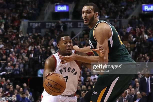 Toronto Raptors guard Kyle Lowry gets choked by Utah Jazz center Rudy Gobert as the Toronto Raptors play the Utah Jazz at Air Canada Centre in...
