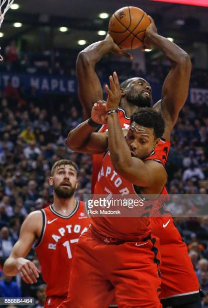 Toronto Raptors guard Kyle Lowry gets out of the way as Toronto Raptors forward Serge Ibaka rips a rebound Toronto Raptors vs Phoenix Suns in 1st...